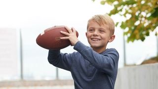 Carter holding a football