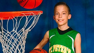 Will in his basketball uniform