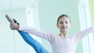 Young girl doing ballet stretch