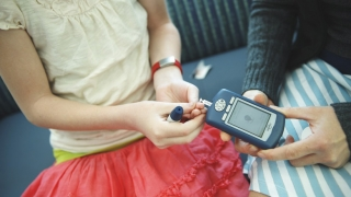 girl testing blood sugar