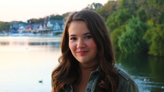Emily IBD patient outside smiling at boathouse row