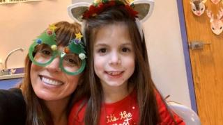 girl and mom smiling christmas costumes