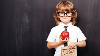 boy holding lunch bag