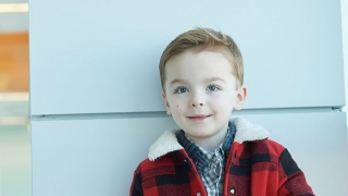 Toddler-age boy smiling