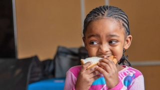 Young girl eating a sandwich