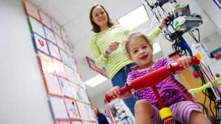 girl on tricycle in the hospital