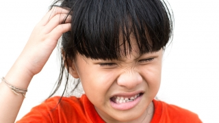 Girl Scratching Head