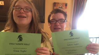 Grace and Gabriel holding up Honor Roll Awards