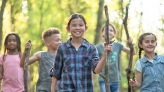 Group of kids walking in woods