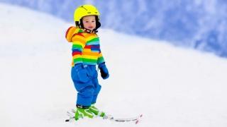 Toddler boy skiing