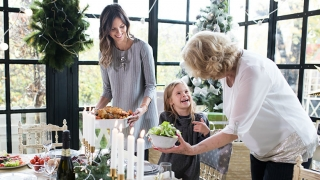 Grandmother, mother and child at holiday table