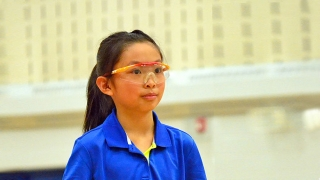 Young girl wearing protective goggles