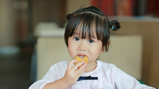 Girl eating chicken nugget