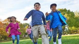 Group of kids running outside