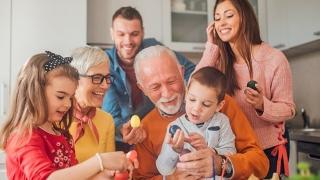 Children and grandparents holding Easter eggs