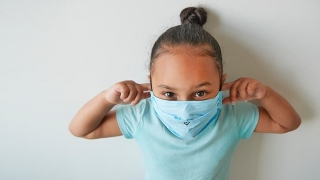 Young girl wearing protective face mask