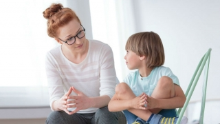 Mom talking to young son