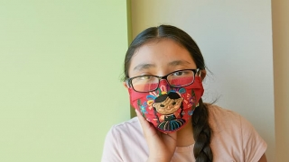 Teen girl wearing a protective mask
