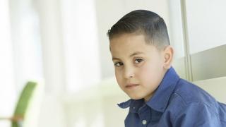 School-aged boy looking sad