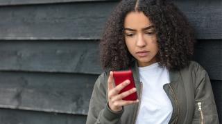 Teen girl looking at her smartphone