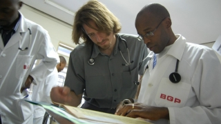 Henry Welch looking at charts with team in Botswana