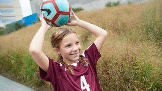 Gabriella holding a soccer ball