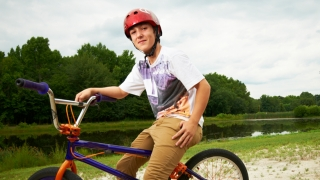 boy with biking helmet