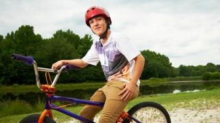 boy with biking helmet