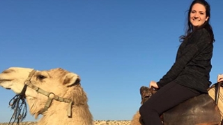 Jessica CF patient riding a camel in Israel