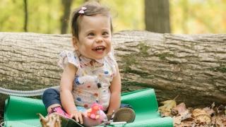 Josephine smiling sitting outside