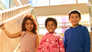 Kids inside the Karabots building
