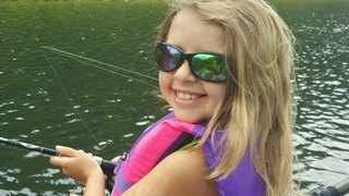 Kenzie outside fishing