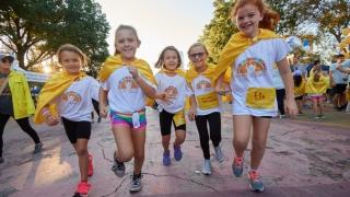 kids running towards camera smiling