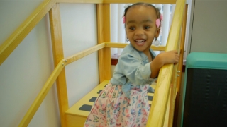 Leukodystrophy Center patient smiling standing on stairs