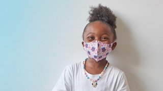 Young girl wearing a protective mask