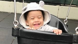Lucas in baby swing outside