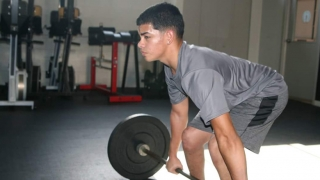 Luis at the gym lifting weights