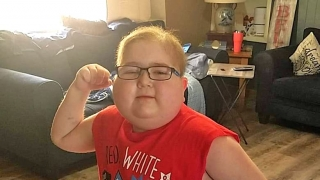 Jacob posing and flexing his muscle