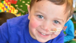 Matthew crohns disease patient smiling in playroom