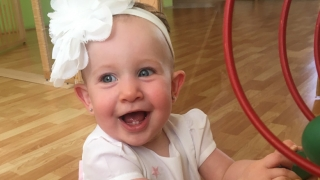 Milana smiling and playing at home