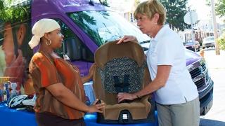 Mobile safety van demonstrates car seat