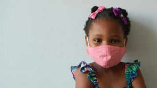 girl in a pink mask