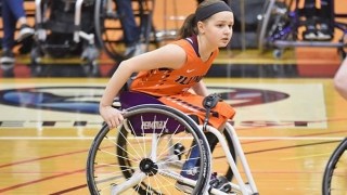 Ruby playing wheelchair basketball