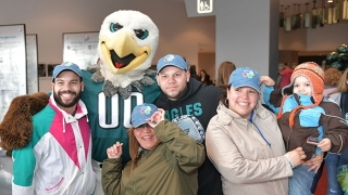 Group photo with Eagles mascot, Swoop