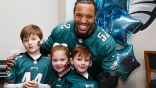 Najee Goode poses with kids at the 8th annual Huddle Up for Autism