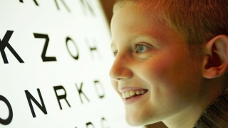 Young boy looking at eye chart