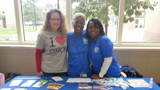 Community Relations team at Health Fair table