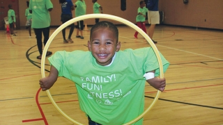 Young boy playing with a hula hoop