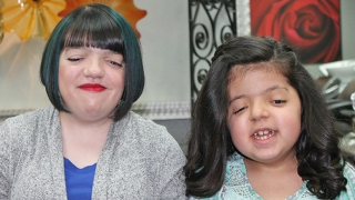 Two girls smiling with new haircuts