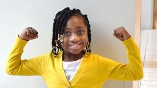 Young girl flexing her muscles